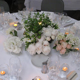 a mix of greenery table decorations @elloirevents