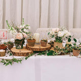 wooden trio teired log table decorations @elloirevents