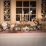 Gift table with card basket decorated with photographs @elloirevents