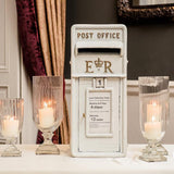 White postbox with candle lit decor @elloirevents