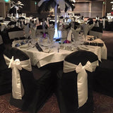 Black lycra chair covers decorated with bows @elloirevents