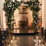 Square archways decorated in greenery and white flowers @elloirevents