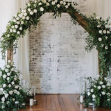 Greenery wreath decorated archway @elloirevents