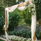 Square archway covered in flowers and linen @elloirevents