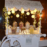 light up decorated vintage candy cart available for party hire @elloirevents
