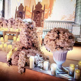 Floral dangling head table decorations surrounded by tea lighted candles @elloirevents