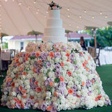 Cake table covered in flowers @elloirevents