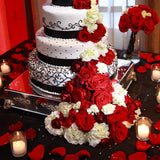 Red and black petals on cake table @elloirevents