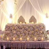 Large floral decorations covering the whole top table @elloirevents