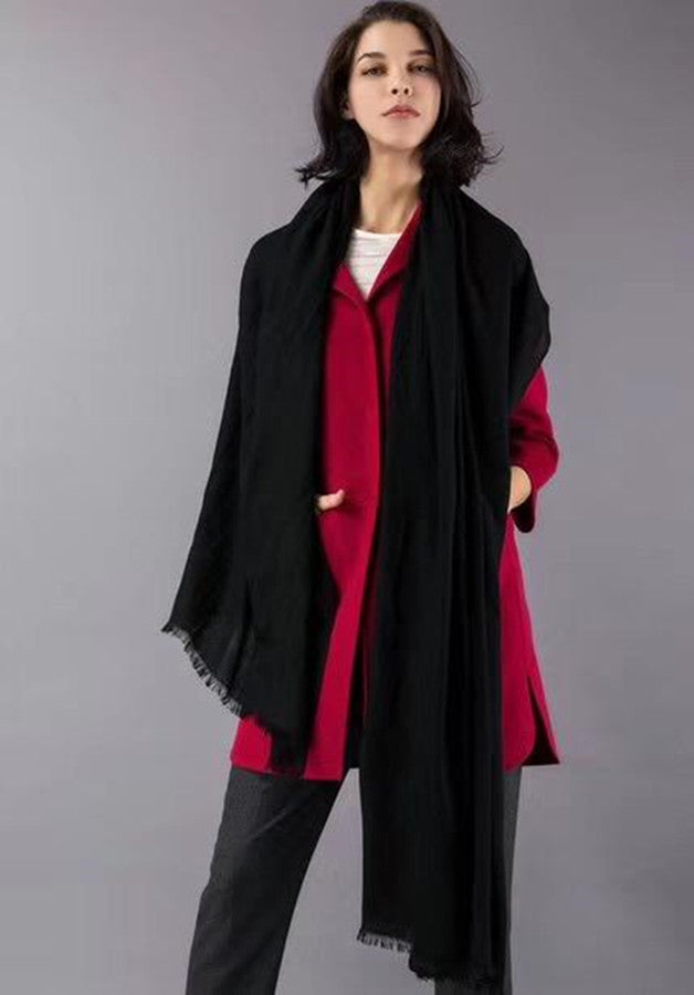 a woman in black cashmere scarf