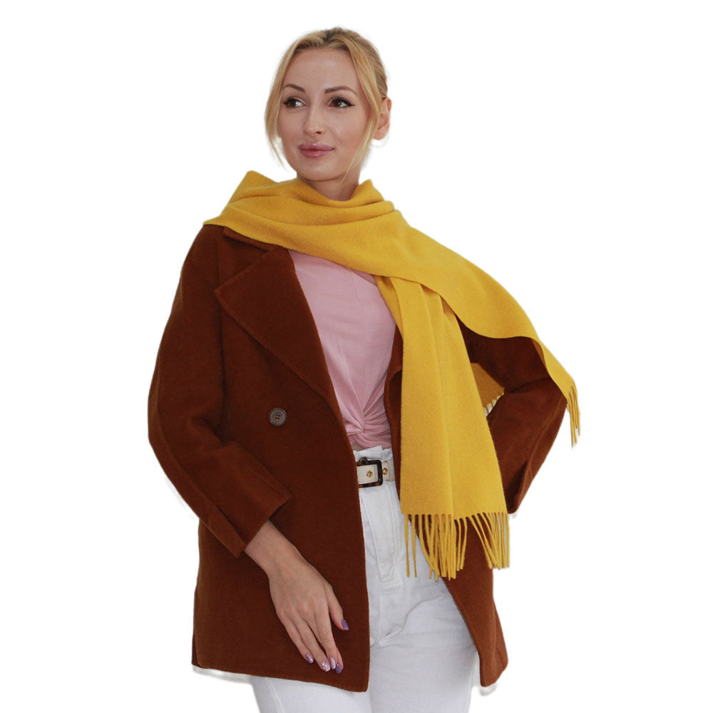 a woman in yellow cashmere scarf