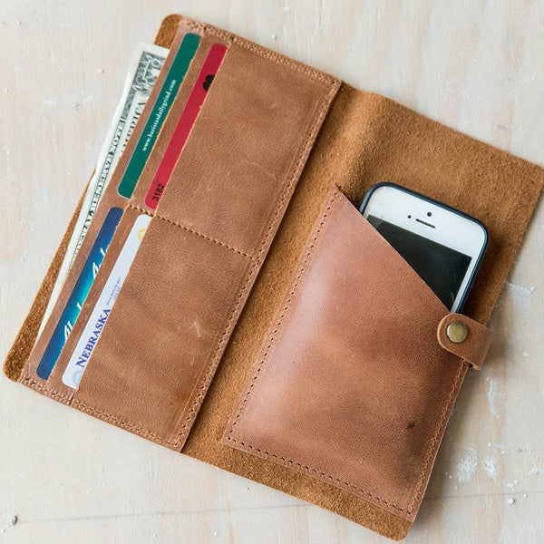 Interior of leather phone wallet holds cards, money and phone