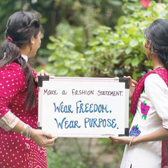 Purpose Jewelry Wear Purpose Wear Freedom - girls in India hold sign