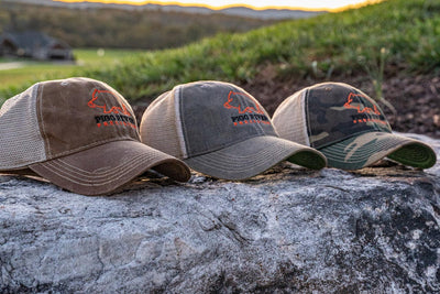 Pigg River Precision Hats grouped on  a rock.- Sharps Mountain - SharpsMountain.com