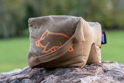 On a rock with orange pigg logo visible Shmedium Mid-Sized Gamechanger™ with Pigg River Logo - Sharps Mountain - Pigg River Precision - Sharpsmountain.com
