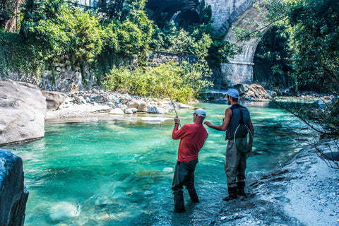 TWo Angler Fishing In A Crystal Mera Clear River, Italy