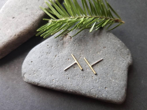 Handmade brass bar studs with sterling silver ear posts. Brass bars measure ½ inches in length.