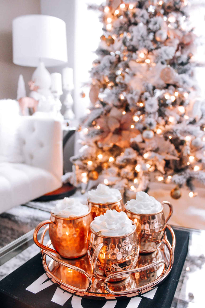 Snow Flocked Tree with Rose Gold Ornaments