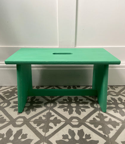 Little vintage wooden stool painted in green chalk paint