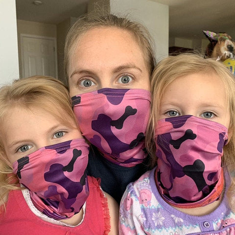 Mom and kids wearing pup scruffs as face masks
