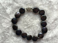 lovely black mother of pearl disk beaded bracelet