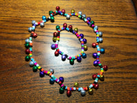 multicolor christmas beaded jingle bell stretch necklace and bracelet set
