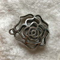 large silvertone puffy open rose pendant