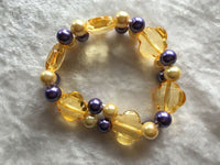 gold and purple flowers acrylic beaded stretch bracelet