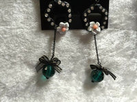 Long Black and Green Daisy Flower Dangle Earrings
