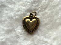Dainty Gold Tone heart within Heart Pendant