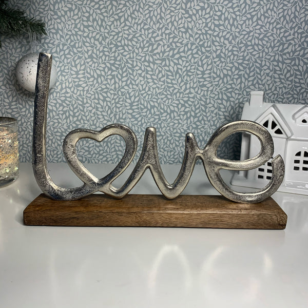 "Metal ""Love"" Letter on Wooden Block"