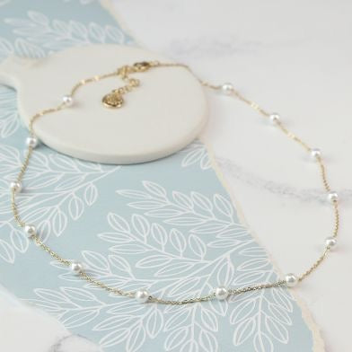 Gold plated necklace with white pearls