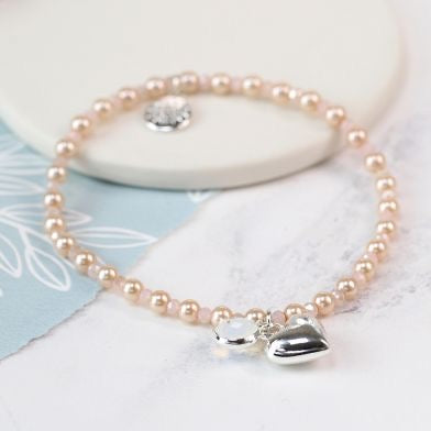Silver plated heart, crystal and champagne pearl bracelet