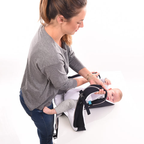 Cococho Baby Carrier- the baby is secured in the carrier before wearing