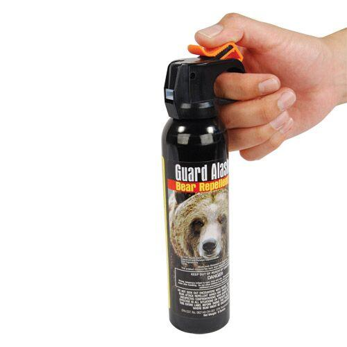 Bear spray safety tab for the trigger to prevent accidental discharges.