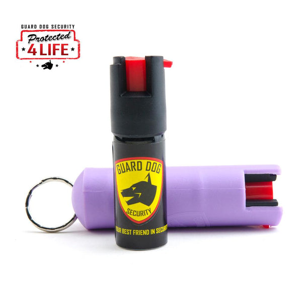 Bulk wholesale discount pricing for the Guard Dog lilac color hard-case pepper sprays for self defense protection.