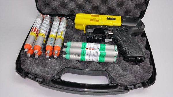 The FIRESTORM JPX 4 shot LE defender yellow barrel pepper gun bundle package.