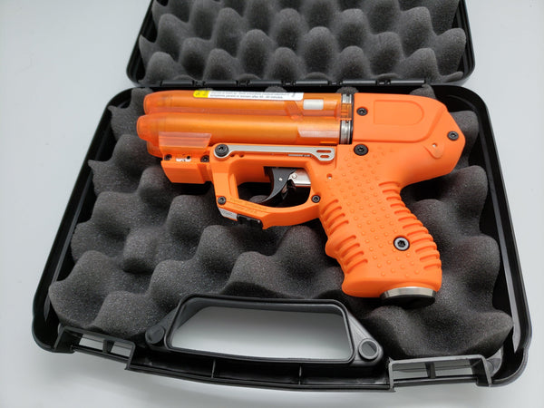 The FIRESTORM orange JPX 6 compact 4 shot pepper gun with laser light bundle package.