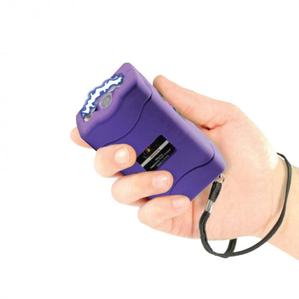 Jolt color purple mini stun gun with safety disable pin for self defense protection.