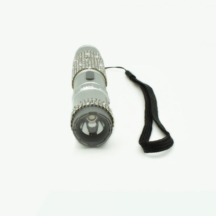 High power electrode flashlight stun gun with rhinestones for her offers personal protection.