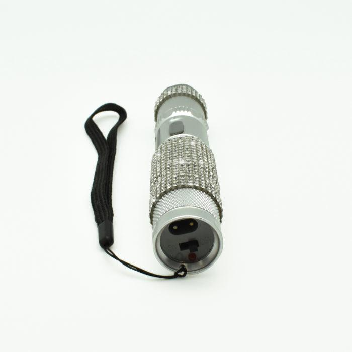 High power electrode flashlight stun gun with rhinestones.
