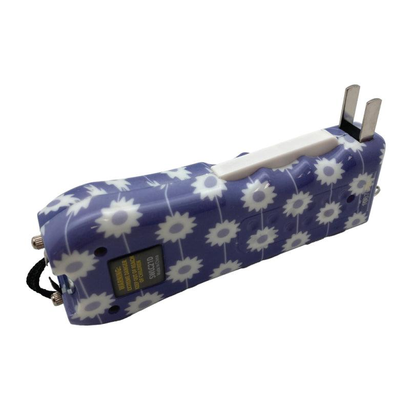 Streetwise Ladies Choice stun gun with purple color daisy design for women shows the squeeze lever to activate.