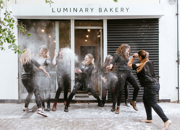 Luminary Team Throwing Flour Photo