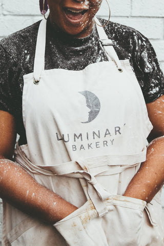 Luminary Trainee with hands in Apron