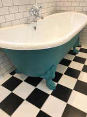 victorian bathroom with cast iron bath and black and white floor tiles