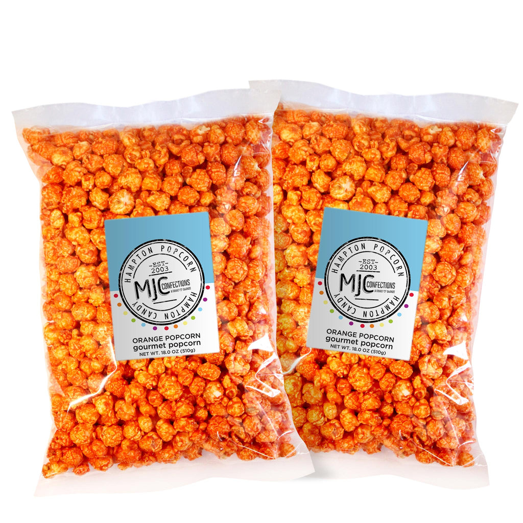 This is a 2 pack of popcorn bags filled with orange popcorn.