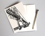 Art print card featuring a block print design by Natalia Wohletz of Peninsula Prints depicting the Mackinac Bridge, the longest suspension bridge in the Western Hemisphere.