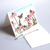Coneflower Patch card features an original block print design by Natalia Wohletz of Peninsula Prints.  The design exudes joy with its bright colors, beautiful blooms and buoyant butterflies.