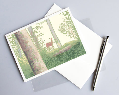 Deer in the Woods Card features a linoleum block print design by Natalia Wohletz of Peninsula Prints. Blank inside.