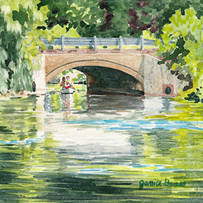 Central Park is an original watercolor by Michigan Artist Janic Dumas. The piece depicts a relaxing scene of a couple paddling a canoe on the Huron River in Milford, Mich. This small piece looks great on an easel or may be framed.